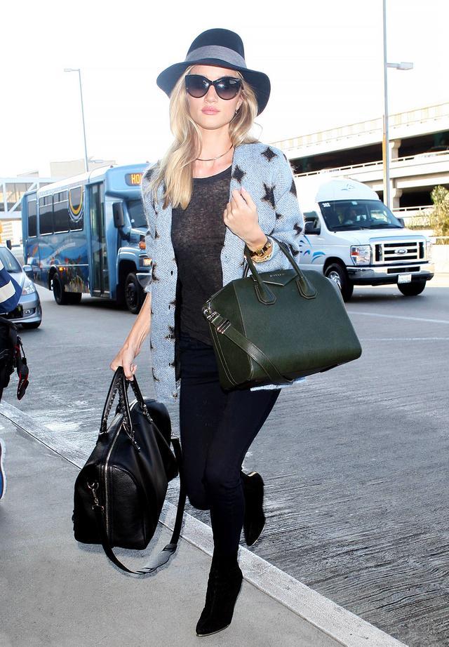 On Huntington-Whiteley: Rag & Bone hat; Saint Laurent sweater; Chanel sunglasses; Jennifer Fisher choker;Balenciaga Voyage Bag ($1875); Givenchy bag.