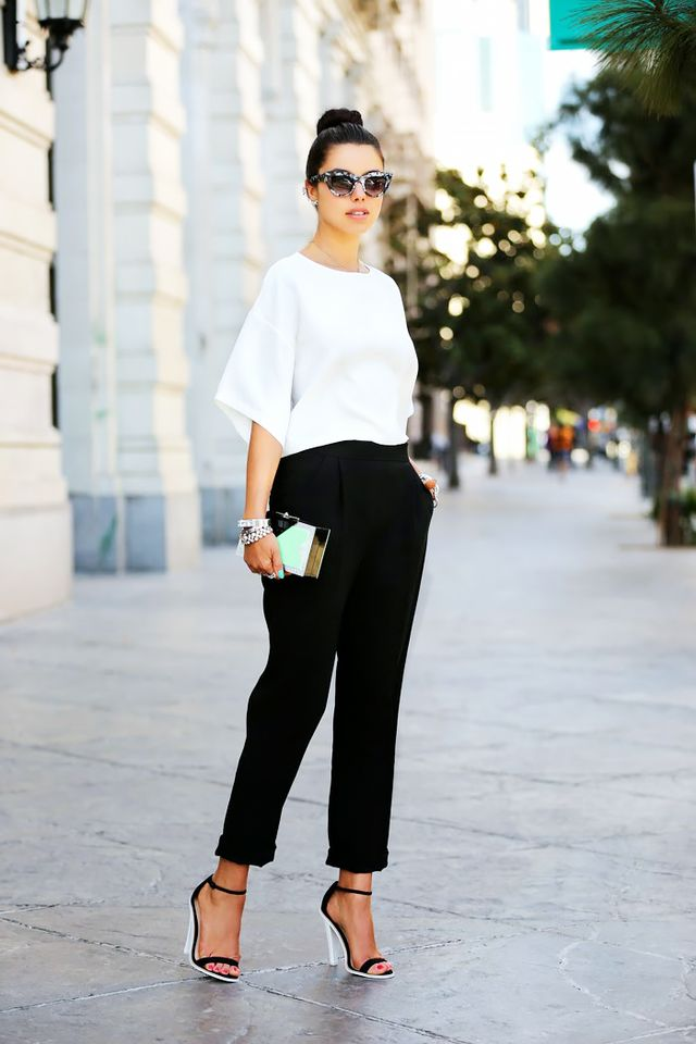 When in doubt, opt for the no-fail combination of a solid silk blouse and black trousers.