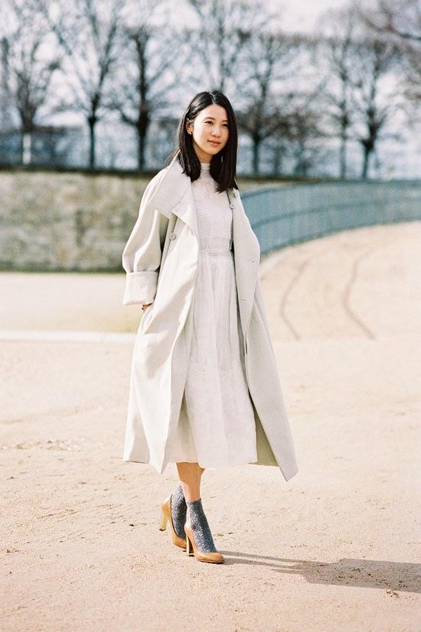 Get The Look: Nina Ricci Contrast-Cuff Trenchcoat ($2150)  Image via Vanessa Jackman