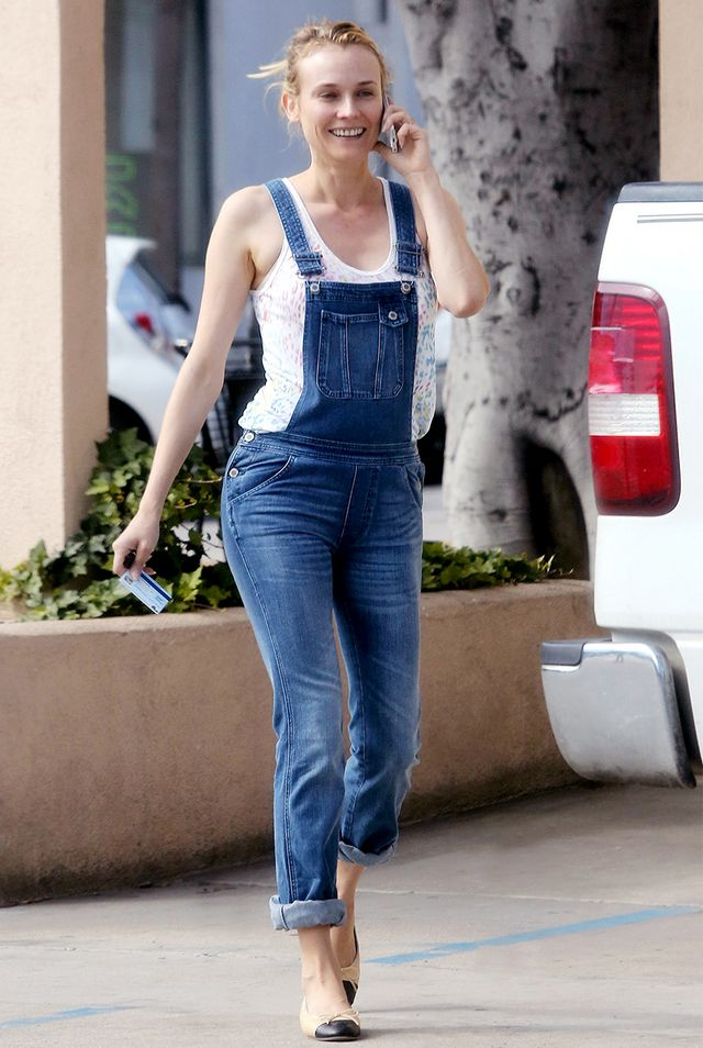 Style Tip: A loosely-rolled cuff is an easy way to give your overalls a seasonal update.  ?On Kruger: MiH Bib & Brace Overalls ($285); Chanel shoes.