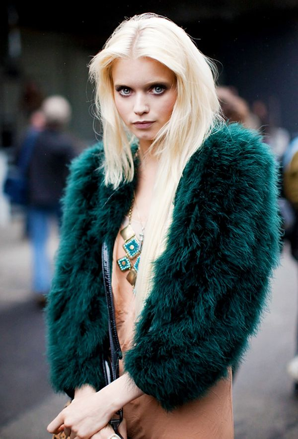 Thanks to this image, we're convinced our closet needs a furry emerald shrug.  Photo courtesy ofStockholm Street Style