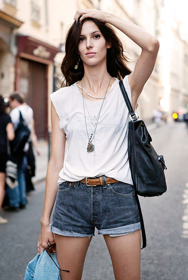 Tip #6: Inspired by the model-off-duty look? So are we. Emulate this cool-girl vibe, and try a pair of short denim shorts with a slouchy t-shirt, layered necklaces, and a leather bag.