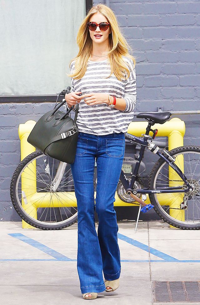Try a pair of flared jeans with platform sandals and a striped shirt for an on-point denim look.