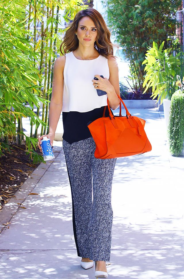 If your office is typically on the conservative side, keep your Friday wardrobe ultra-professional with printed slacks and pumps. Colour-blocking and bright accessories add interest.