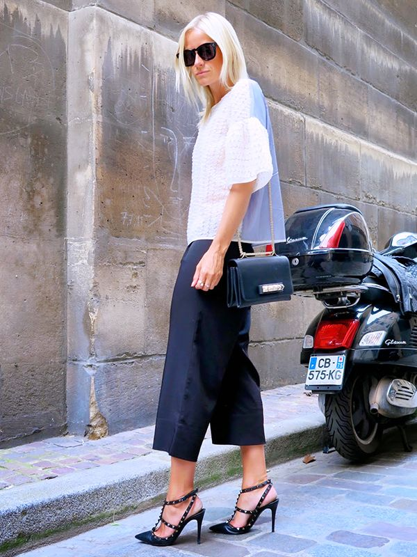 On Celine Aagaard of Hippie Hippie Milkshake: Baum Und Pferdgarten top; Intro Muse culottes; Valentino Rockstud Leather Pumps ($1075) and Va Va Voom Leather Shoulder Bag ($2045) in Black; Celine...